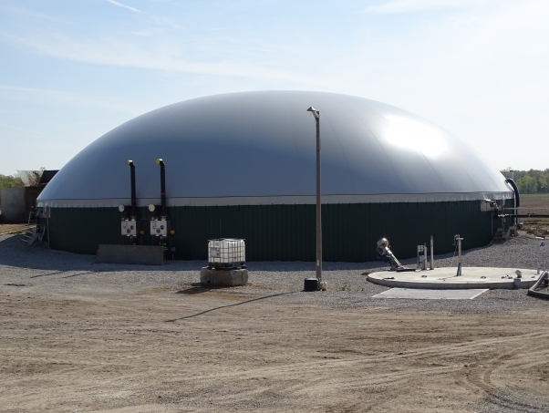 Digester installed by DLS Biogas with a low temperature pasteurizer and liquid receiving pit pictured
